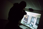 Computer simulation. Armed Police, firearms and tactical training at the Cleveland and Durham Police Tactical Training Centre, Stockton. - Mark Pinder - 08-08-2001