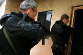 Armed Police forcing their way in, firearms and tactical training at the Cleveland and Durham Police Tactical Training Centre, Stockton. - Mark Pinder - 08-08-2001
