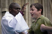 Archbishop of York Dr John Sentamu conducts his annual full body immersion outdoors baptism in a tank of water on the steps of York Minster on the Saturday before Easter, York Minster, York, UK. - Mark Pinder - 08-04-2012