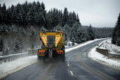 A Northumberland County Council road gritting lorry spreading salt on the C200 road near Kielder, Northumberland, 9/2 2009. - Mark Pinder - 09-02-2009