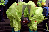 Firefighters evacuate a volunteer victim from the Banqueting hall at Newcastle Civic Centre during Operation Magpie, a multi agency civil defence exercise simulating a chemical weapon attack on Newcas... - Mark Pinder - 28-04-2004
