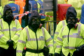 Police in chemical weapon protection gear at Operation Magpie, a multi agency civil defence exercise based around a notional chemical weapon attack on Newcastle City Council Civic Centre. The event wa... - Mark Pinder - 28-04-2004