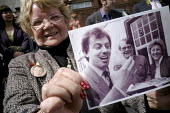 A supporter of Tony Blair, Lena Devine, attending his resignation timetable announcement rally holds up a photo of herself with Blair taken in sedgefield Village in 1984, the year after he became memb... - Mark Pinder - ,2000s,2007,Parliament,POL politics,rallies,rally,resignation,supporter,TIME,timetable,Village,VILLAGES,woman women