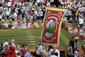 Durham area Vane Tempest Lodge miners banner coming onto the field at Durham Miners Gala, Durham 2009. - Mark Pinder - ,2000s,2009,ACE arts culture & entertainment,ace culture,activist,activists,banner banners,CAMPAIGN,campaigner,campaigners,CAMPAIGNING,CAMPAIGNS,County Durham,DEMONSTRATING,demonstration,DEMONSTRATION