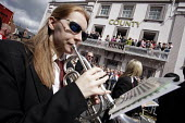 A brass band passes the guests on the balcony of the County Hotel at the 2009 Durham Miners Gala. - Mark Pinder - 11-07-2009