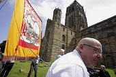 Miners and NUM banner waiting in line to go into Durham Cathedral for the traditional miners rememberance service at the 2009 Durham Miners Gala, Durham. - Mark Pinder - 11-07-2009