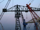 The cranes of Swan Hunter shipyard in Wallsend on the River Tyne are to be consigned to history following the closure of the yard. The cranes are being dismantled and exported to the Bharati Shipyard... - Mark Pinder - 2000s,2007,buy,buyer,buyers,buying,capitalism,capitalist,cityscape,cityscapes,CLOSED,closing,closure,closures,commodities,commodity,crane cranes,dawn,deindustrialisation,Deindustrialization,dusk,EBF E