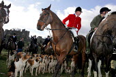 Huntsmen from the Percy Hunt Alnwick, Northumberland. The day after the hunting ban. - Mark Pinder - 2000s,2005,AFFLUENCE,AFFLUENT,animal,animal animals,animals,ban,banned,banning,blood sports,Bourgeoisie,canine,castle,class,country,countryside,dog,dogs,domesticated ungulate,domesticated ungulates,el