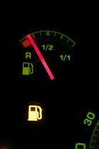 A car fuel gauge showing almost empty. 12/9 2005. - Mark Pinder - 12-09-2005
