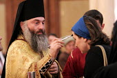 A woman is blessed by the priest at Friday Mass at the Georgian Orthodox Sameba Church, Tbilisi, Georgia, 20/5 2005. - Mark Pinder - 2000s,2005,Apostolic,Catholicism,Caucasus,christian christians,christianity Christian,Church,churches,congregation,Georgia,Georgian,god,Mass,monotheistic,orthodox,priest priests,RLB religion & belief,