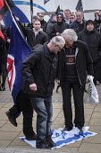 Stamping on the Israeli flag, Alliance of fascist groups including the British Movement, National Alliance and Azov hold a White Man March rally, Newcastle Upon Tyne - Mark Pinder - 21-03-2015