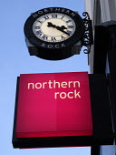 The Northern Rock Clock and sign outside the Northumberland Street, Newcastle branch of the bank - Mark Pinder - 2000s,2007,bank,banking,banking crisis,banks,buy,buyer,buyers,buying,commodities,commodity,credit crunch,DOWNTURN,EBF economy business & finance,finance,FINANCIAL,financial crisis,goods,mortgage mortg