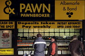 A branch of high street pawnbrokers Albemarle and Bond in North Shields, Tyne and Wear. - Mark Pinder - 2000s,2009,advances,bank,banking,banks,borrower,borrowers,borrowing,buy,buyer,buyers,buying,capitalism,capitalist,cash,cheque Cashing,commodities,commodity,company companies,cost of living,customer cu