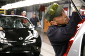 Nissan car workers do a quality control check on Nissan Micra cars which have just rolled off the production line. Nissan car plant at Washington near Sunderland. - Mark Pinder - 25-09-2006