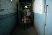 Miners at Kellingley Colliery, (The Big K), near Pontefract in East Yorkshire, in the lamp room prior to going on shift. Knottingley. - Mark Pinder - 27-02-2009
