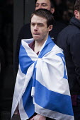 Pegida supporter draped in an Israeli flag, Pegida rally, Newcastle Upon Tyne, UK - Mark Pinder - 28-02-2015