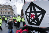 Pegida supporter wearing a motorcycle helmet with a swastika in a Star of David, Pegida rally, Newcastle Upon Tyne - Mark Pinder - 28-02-2015