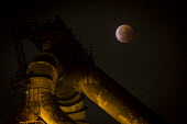 Lunar eclipse over the SSI Redcar steelworks blast furnace. SSI have announced the plant will be mothballed, with the loss of 1,700 jobs. Redcar, Co Cleveland - Mark Pinder - 2010s,2015,blood,capitalism,capitalist,closed,closing,closure,closures,deindustrialisation,Deindustrialization,EBF,eclipse,ECLIPSED,ECLIPSES,Economic,Economy,employment,ENI,environment,Environmental I