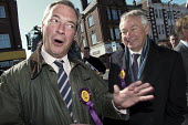 UKIP leader Nigel Farage campaigning during the 2013 South Shields by-election, Tyne and Wear, UK. Farage with the UKIP candidate Richard Elvin. - Mark Pinder - ,2010s,2013,CAMPAIGN,campaign campaigning,campaigning,CAMPAIGNS,candidate,candidate candidates,CANDIDATES,democracy,election elections,eurosceptic,Euroscepticism,eurosceptics,far right,far right,journ