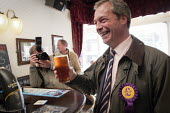 Farage surrounded by press has a pint of beer in a pub in the constituency. UKIP leader Nigel Farage campaigning during the 2013 South Shields by-election, Tyne and Wear, UK, 30/4 2013 - Mark Pinder - ,2010s,2013,beer,camera,cameras,CAMPAIGN,campaign campaigning,campaigning,CAMPAIGNS,democracy,drink,drinker,drinkers,drinking,election elections,eurosceptic,Euroscepticism,eurosceptics,far right,far r