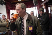 Farage surrounded by press has a pint of beer in a pub in the constituency. UKIP leader Nigel Farage campaigning during the 2013 South Shields by-election, Tyne and Wear, UK, 30/4 2013 - Mark Pinder - 2010s,2013,beer,CAMPAIGN,campaign campaigning,campaigning,CAMPAIGNS,democracy,drink,drinker,drinkers,drinking,election elections,eurosceptic,Euroscepticism,eurosceptics,far right,far right,leader,mp m