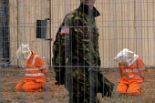 The artist Jai Redman has created a version of the USA Camp X-Ray at Guantanamo Bay on waste-land in Hulme, Manchester. Nine volunteers, (to represent the number of British detainees at Guantanamo Bay... - Mark Pinder - 13-10-2003