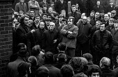 Mass meeting of miners from Wheldale colliery, near Castleford, West Yorkshire during 1972 strike, addressed by Pete Bolderson of Glasshoughton. - NLA - Miners Strike, Miner's Strike NUM, Trades Union,1970s,1972,collieries,colliery,communicating,communication,conversation,conversations,democracy,dialogue,discourse,DISCUSS,discusses,discussing,discussi