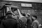 Miners pickets at West Drayton Coal depot West London during 1972 strike. - NLA - , Miners Strike, Miner's Strike NUM, Trades Union,1970s,1972,adult,adults,Coal,coal depot,communicating,communication,conversation,conversations,dialogue,discourse,DISCUSS,discusses,discussing,discuss