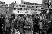 Derbyshire miners wives demonstrate outside parliament in support of their husbands. - NLA - ,1970s,1972,activist,activists,banner banners,CAMPAIGN,campaigner,campaigners,CAMPAIGNING,CAMPAIGNS,demonstrate,DEMONSTRATING,demonstration,DEMONSTRATIONS,Derbyshire,dispute,disputes,EARNINGS,EQUALITY