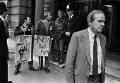 Stan Orme, Labour Energy Spokesman passes Kent miners as he leaves the NCB HQ after failing to negotiate a settlement to the miners strike - Peter Arkell - ,1980s,1984,adult,adults,confront,confrontation,confronted,confronting,DISPUTE,DISPUTES,Energy,failing,INDUSTRIAL DISPUTE,Kent,leaves,MATURE,member,member members,members,MINER,Miners,MINER'S,miners s