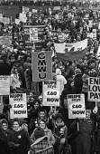 Members of NUPE and other trades union demonstrate for higher wages - 60 minimum pay - during the Winter of Discontent - NLA - 1970s,1979,£60,DEMONSTRATING,demonstration,discontent,disputes,EARNINGS,EQUALITY,FEMALE,GMWU,Government,Income,INCOMES,INDUSTRIAL DISPUTE,inequality,living wage,London,low,Low Pay,Low Income,low paid