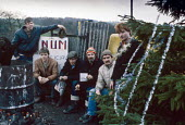Picket Line at Christmas with tree, Denby Grange colliery - NLA - 1980s,1984,Christmas,collieries,colliery,Denby,DISPUTE,DISPUTES,Grange,INDUSTRIAL DISPUTE,member,member members,members,mine,miner,Miners,MINER'S,Miners Strike,Miner's Strike,mines,NUM,people,picket,P