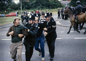 Arrest of miner in Yorkshire. - NLA - 1980s,1984,adult,adults,animal,animals,arrest,arrested,arresting,CLJ,DISPUTE,DISPUTES,domesticated ungulate,domesticated ungulates,equestrian,equine,force,horse,horses,INDUSTRIAL DISPUTE,MATURE,member