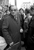 UCATT leader George Smith brushes past his members as he goes into pay talks with the employers before the strike for 35 for 35 hour week and an end the the Lump. London - NLA - 08-02-1972