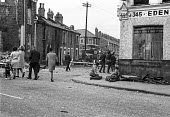 British soldiers on the streets of the Catholic Ardoyne district, Belfast 1969 shortly after their deployment to Northern Ireland. Locals look at burnt out buildings and buses following days of riotin... - NLA - 1960s,1969,Ardoyne,Armed Forces,army,Belfast,British,British Army,buildings,burnt,Burnt Out,bus,bus service,buses,catholic,catholics,cities,city,communities,community,conflict,conflicts,FEMALE,Irish,m