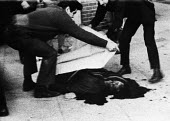 Blanket is drawn over the body of one of the 13 demonstrators shot dead by British paratroopers, Bloody Sunday, Derry, Northern Ireland 1972 - NLA - ,1970s,1972,Bloody,bodies,body,British,British Army,conflict,conflicts,confront,confrontation,confronted,confronting,corpse,corpses,dead,dead body,death,deaths,demonstrators,Derry,died,gunshot,Ireland
