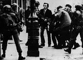 Men from Derry carrying an injured man confronting British paratroopers over the shooting, Bloody Sunday Derry Northern Ireland 1972 - NLA - 30-01-1972