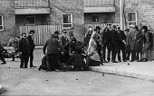 Demonstrators crowd round protestor shot by British paratroopers, Bloody Sunday, Derry, Northern Ireland 1972 - NLA - ,1970s,1972,Bloody,bodies,body,British,British Army,conflict,conflicts,confront,confrontation,confronted,confronting,dead,dead body,death,deaths,demonstrators,Derry,died,Ireland,Irish,Londonderry,mort