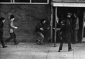 Woman reaching out to an injured man trying to reach safety after being shot by British paratroopers, Bloody Sunday, Derry, Northern Ireland 1972 - NLA - 30-01-1972