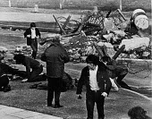 Injured Civil Rights marchers lie on the ground after being shot by British paratroopers, Bloody Sunday, Derry, Northern Ireland 1972 - NLA - 1970s,1972,Bloody,British,British Army,Burning Barricade,civil rights,conflict,conflicts,confront,confrontation,confronted,confronting,demonstrators,Derry,Injured,INJURIES,INJURY,Ireland,Irish,Londond