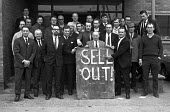 Ford strike 1971. Sell Out! Ford workers at the Basildon tractor factory show what they think about the settlement at the end of the national strike. - NLA - 1970s,1971,automotive,car industry,carindustry carindustry,disputes,FACTORIES,factory,Ford,Fords Basildon,Fords strike,INDUSTRIAL DISPUTE,man men,member,member members,members,people,placard placards,