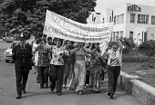 Strike for equal pay by 350 women at Trico. The women take to the streets soon after walking out of the plant in West London, when management refused to make up the �6 pay differential between men and... - NLA - ,1970s,1976,activist,activists,AUEW,banner banners,CAMPAIGN,campaigner,campaigners,CAMPAIGNING,CAMPAIGNS,DEMONSTRATING,demonstration,DEMONSTRATIONS,disputes,equal pay,equal pay strike,equal rights,equ