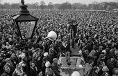 TV film crew filming fron the roof of a car. Mass meeting of Post Office workers in Hyde Park, London, during the 1971 strike - NLA - 25-02-1971