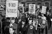 Ford workers join a march through London in support of UPW workers during the 1971 postal workers strike - NLA - 1970s,1971,activist,activists,against,CAMPAIGN,campaigner,campaigners,CAMPAIGNING,CAMPAIGNS,DEMONSTRATING,demonstration,DEMONSTRATIONS,dispute,disputes,EARNINGS,Ford,Income,INCOMES,INDUSTRIAL DISPUTE,