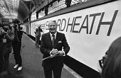 Former Prime Minister Ted Heath with his Come and Meet Ted Heath train, after losing the leadership of the Conservative Party to Margaret Thatcher - NLA - 1970s,1977,campaign,campaigning,CAMPAIGNS,CONSERVATIVE,Conservative Party,conservatives,Edward Heath,Minister,network,Party,pol,political,POLITICIAN,POLITICIANS,politics,Ted Heath,train,TRAINS