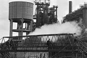 Corby. Workers come off shift, dwarfed by the steelworks - NLA - ,1970s,1979,British Steel,BSC,capitalism,capitalist,closed closure,Corby,EBF Economy,FACTORIES,factory,Industries,INDUSTRY,ISTC,maker,makers,making,man men,manufacture,manufacturer,manufacturers,manuf