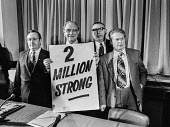 Jack Jones, Moss Evans, Harry Urwin TGWU trade union reaches 2 million members. - NLA - 1970s,1977,2,Evans,Harry,Jack,Jones,male,man,mass,member,member members,members,membership,men,million,Moss,people,person,persons,placard,placards,TGWU,Trade Union,Trade Union,Trade Unionism,trade uni