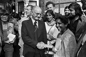 Grunwick strike for union recognition and lock-out 1977. Jayabeen Desai shaking the hand of Hugh Scanlon, leader of the AUEW, visiting picket line to support the strikers - NLA - , Trades Union,1970s,1977,APEX,Asian Asians,at,AUEW,BME black,de recognition,derecognition,dispute,DISPUTES,ethnic,ETHNICITY,Grunwick,Hugh Scanlon,INDUSTRIAL DISPUTE,industrial relations,leader,mass p