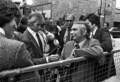 Grunwick strike for union recognition 1977. George Ward, owner of Grunwick, talking to the press by the gates of his factory. Some of the strikers are looking in. - NLA - 13-07-1977