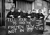 Deptford striking firemen picketing their station, London just before Christmas 1977 - NLA - 1970s,1977,activist,activists,adult,adults,campaigner,campaigners,Christmas,Deptford,DISPUTE,DISPUTES,EARNINGS,EQUALITY,FBU,fire brigade,Firefighter,firefighters,fireman,Firemen,Income,INCOMES,INDUSTR